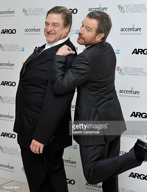 Actors John Goodman and Bryan Cranston attend the 'Argo' premiere during the 56th BFI London Film Festival at the Odeon Leicester Square on October...