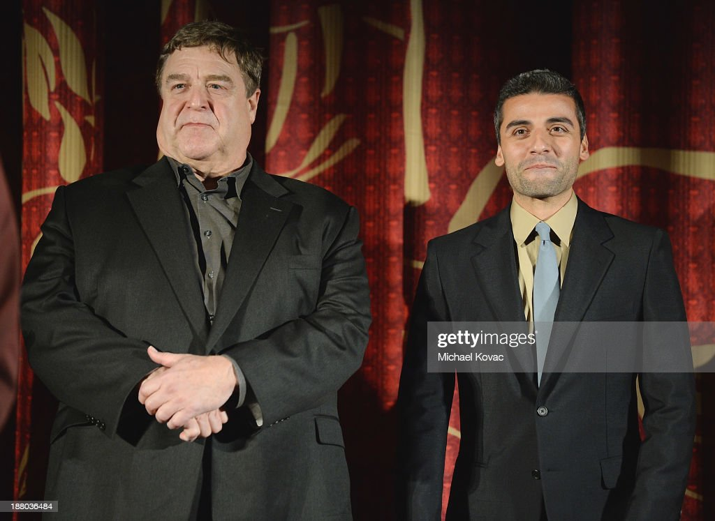 Actors <a gi-track='captionPersonalityLinkClicked' href=/galleries/search?phrase=John+Goodman&family=editorial&specificpeople=207076 ng-click='$event.stopPropagation()'>John Goodman</a> (L) and <a gi-track='captionPersonalityLinkClicked' href=/galleries/search?phrase=Oscar+Isaac&family=editorial&specificpeople=2275888 ng-click='$event.stopPropagation()'>Oscar Isaac</a> attend the AFI FEST 2013 presented by Audi closing night gala screening of 'Inside Llewyn Davis' at TCL Chinese Theatre on November 14, 2013 in Hollywood, California.