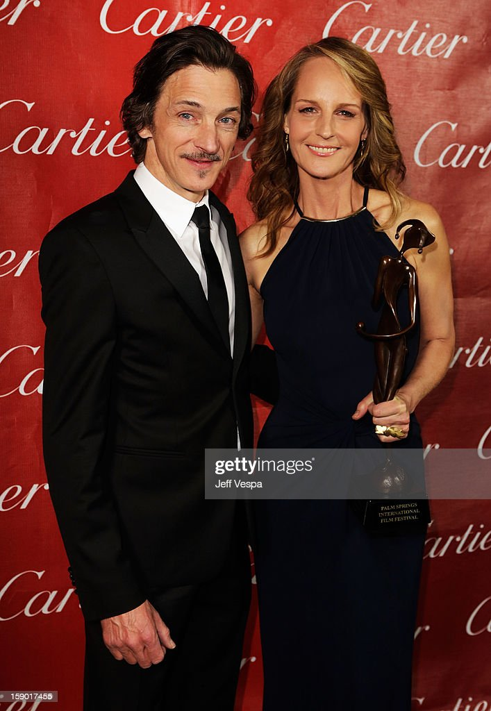 Actors John Hawkes and Helen Hunt pose with the Spotlight Award at the 24th annual Palm Springs International Film Festival Awards Gala at the Palm Springs Convention Center on January 5, 2013 in Palm Springs, California.