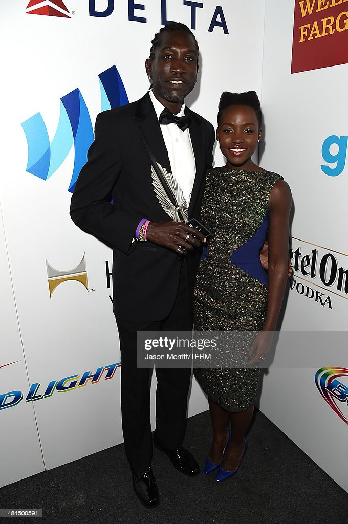 Actors John 'Long Jones' Abdallah (L) and <a gi-track='captionPersonalityLinkClicked' href=/galleries/search?phrase=Lupita+Nyong%27o&family=editorial&specificpeople=10961876 ng-click='$event.stopPropagation()'>Lupita Nyong'o</a> attend the 25th Annual GLAAD Media Awards at The Beverly Hilton Hotel on April 12, 2014 in Los Angeles, California.