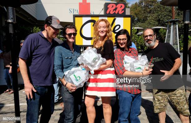 Actors John Pirruccello George Griffith Adele René Josh Fadem and Stewart Strauss pose with water to give out to fans in line at Showtime's 'Twin...