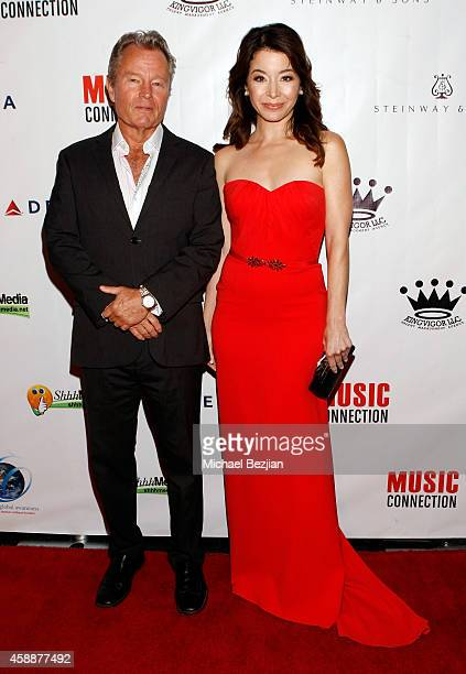 Actors John Savage and Katherine Castro attend Katherine Castro Receives Hollywood FAME Awards at Avalon on November 12 2014 in Hollywood California