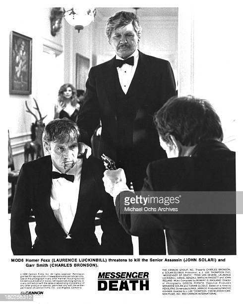 Actors John Solari Charles Bronson and Laurence Luckinbill on set of the movie ' Messenger of Death' in 1988