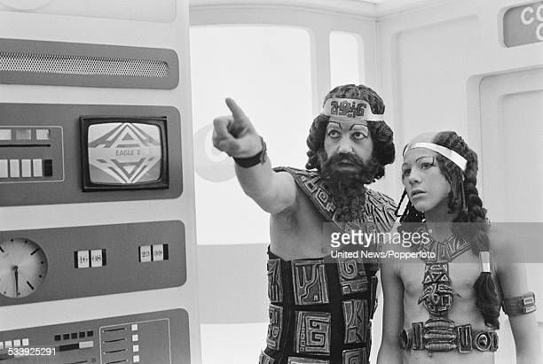 Actors John Standing and Michael Gallagher pictured together dressed in character on set during filming of the science fiction television series...