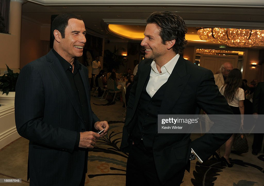 Actors <a gi-track='captionPersonalityLinkClicked' href=/galleries/search?phrase=John+Travolta&family=editorial&specificpeople=178204 ng-click='$event.stopPropagation()'>John Travolta</a> and <a gi-track='captionPersonalityLinkClicked' href=/galleries/search?phrase=Bradley+Cooper&family=editorial&specificpeople=680224 ng-click='$event.stopPropagation()'>Bradley Cooper</a> attend the Hollywood Foreign Press Association's 2012 Installation Luncheon held at the Beverly Hills Hotel on August 9, 2012 in Beverly Hills, California.