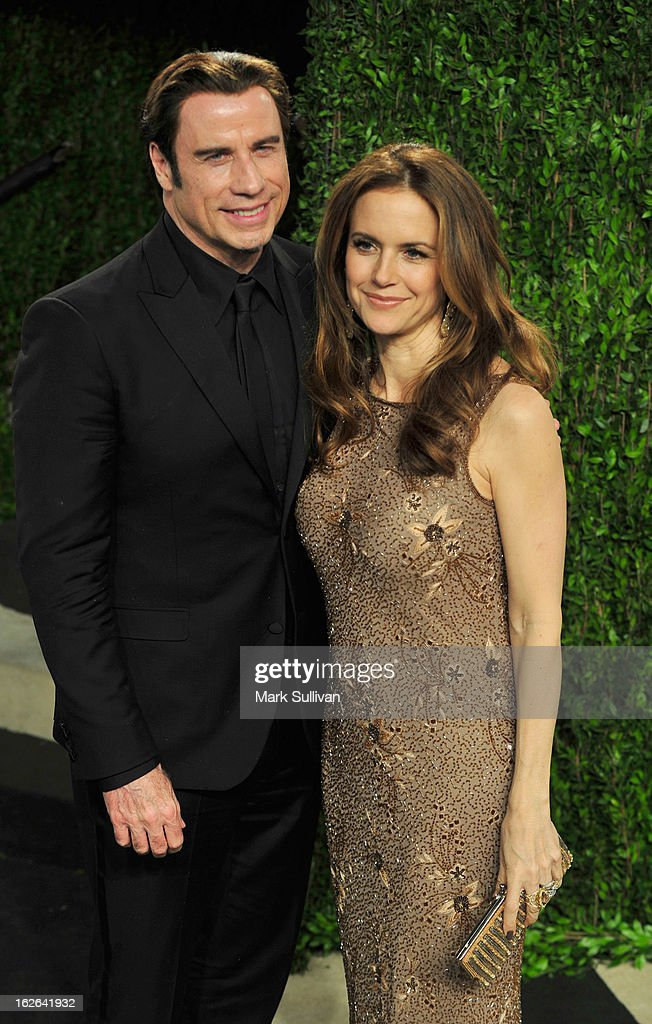 Actors John Travolta (L) and Kelly Preston arrive at the 2013 Vanity Fair Oscar Party at Sunset Tower on February 24, 2013 in West Hollywood, California.