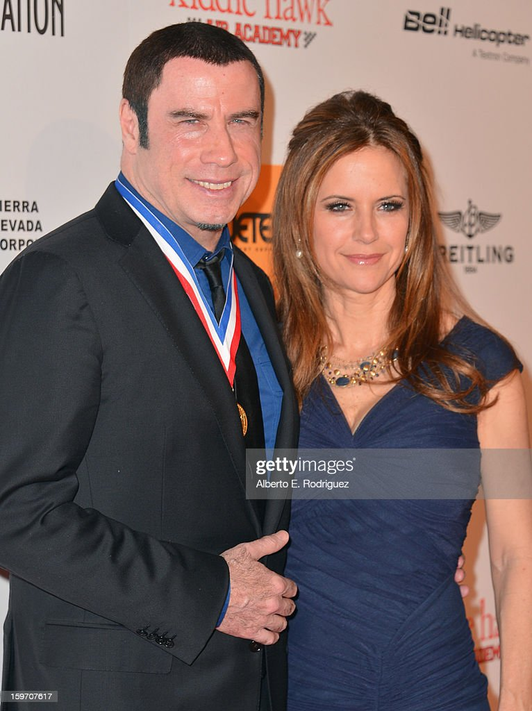 Actors <a gi-track='captionPersonalityLinkClicked' href=/galleries/search?phrase=John+Travolta&family=editorial&specificpeople=178204 ng-click='$event.stopPropagation()'>John Travolta</a> and <a gi-track='captionPersonalityLinkClicked' href=/galleries/search?phrase=Kelly+Preston&family=editorial&specificpeople=159434 ng-click='$event.stopPropagation()'>Kelly Preston</a> arrive to the 10th Annual Living Legends of Aviation Awards at The Beverly Hilton Hotel on January 18, 2013 in Beverly Hills, California.