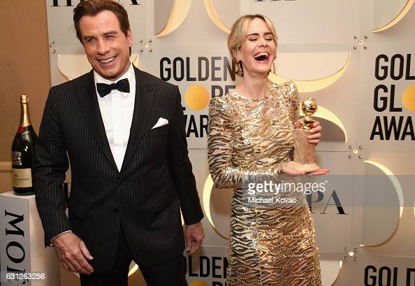 Actors John Travolta and Sarah Paulson attends the 74th Annual Golden Globe Awards at The Beverly Hilton Hotel on January 8 2017 in Beverly Hills...