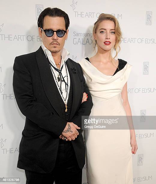 Actors Johnny Depp and Amber Heard arrive at The Art Of Elysium's 8th Annual Heaven Gala at Hangar 8 on January 10 2015 in Santa Monica California