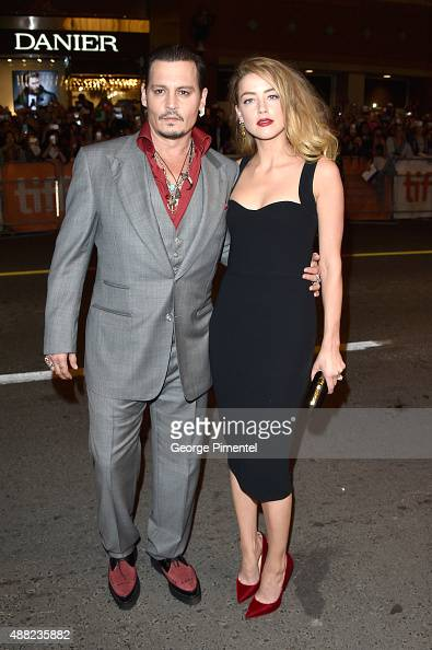 Actors Johnny Depp and Amber Heard arrive at the 'Black Mass' premiere during the 2015 Toronto International Film Festival at The Elgin on September...