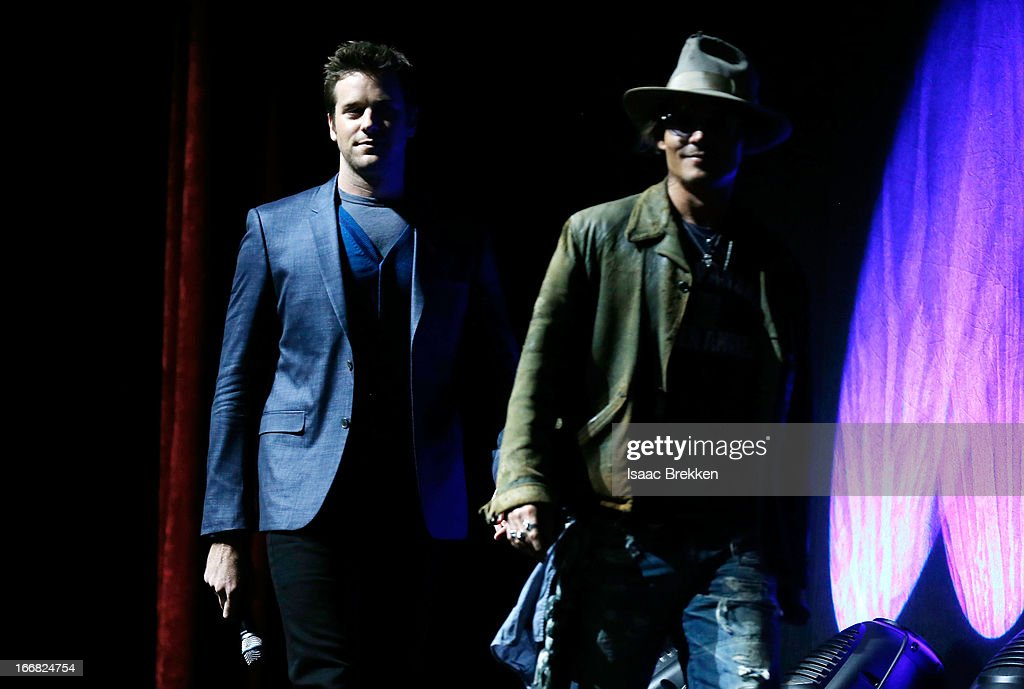 Actors <a gi-track='captionPersonalityLinkClicked' href=/galleries/search?phrase=Johnny+Depp&family=editorial&specificpeople=202150 ng-click='$event.stopPropagation()'>Johnny Depp</a> (R) and <a gi-track='captionPersonalityLinkClicked' href=/galleries/search?phrase=Armie+Hammer&family=editorial&specificpeople=5313113 ng-click='$event.stopPropagation()'>Armie Hammer</a> appear at The Walt Disney Studios Motion Pictures presentation to promote their upcoming film, 'The Lone Ranger' at Caesars Palace during CinemaCon, the official convention of the National Association of Theatre Owners on April 17, 2013 in Las Vegas, Nevada.