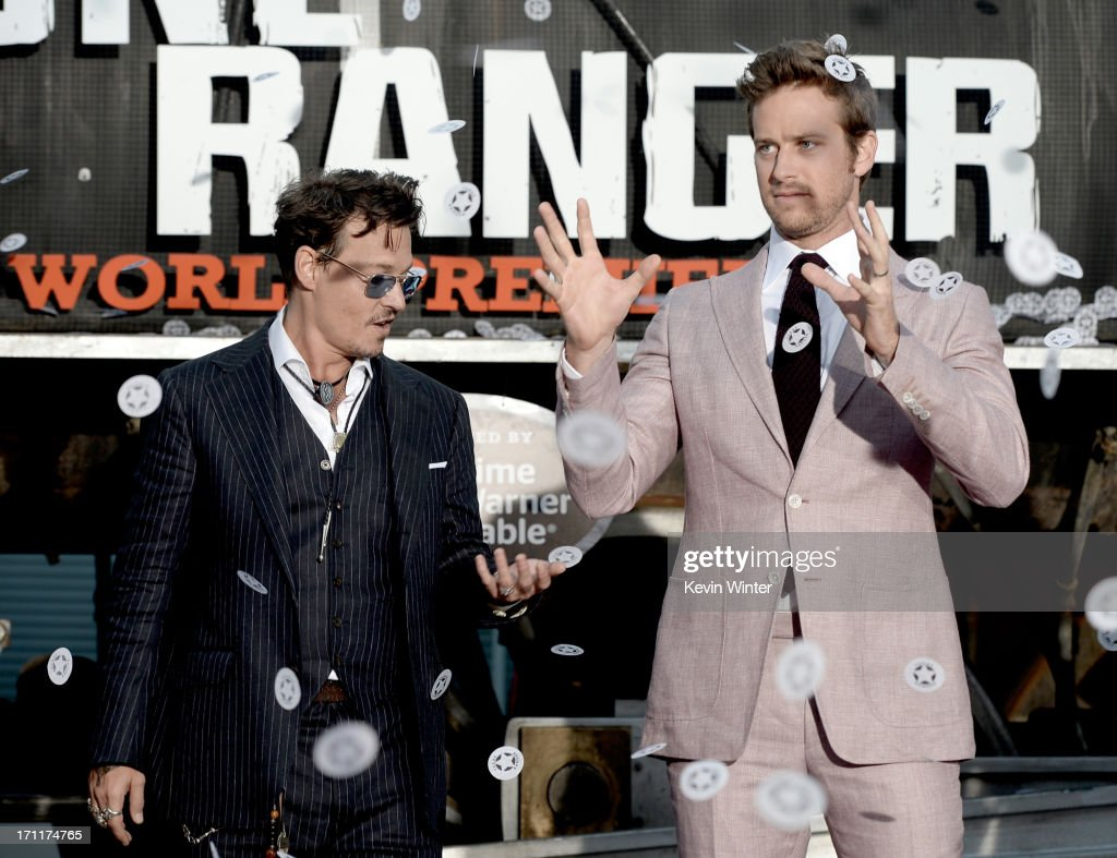Actors <a gi-track='captionPersonalityLinkClicked' href=/galleries/search?phrase=Johnny+Depp&family=editorial&specificpeople=202150 ng-click='$event.stopPropagation()'>Johnny Depp</a> (L) and <a gi-track='captionPersonalityLinkClicked' href=/galleries/search?phrase=Armie+Hammer&family=editorial&specificpeople=5313113 ng-click='$event.stopPropagation()'>Armie Hammer</a> arrive at the premiere of Walt Disney Pictures' 'The Lone Ranger' at Disney California Adventure Park on June 22, 2013 in Anaheim, California.