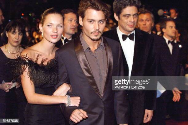 Actors Johnny Depp and Benicio Del Toro accompanied by model Kate Moss arrive 15 May at the Palais des festivals for the screening of the film ' Fear...