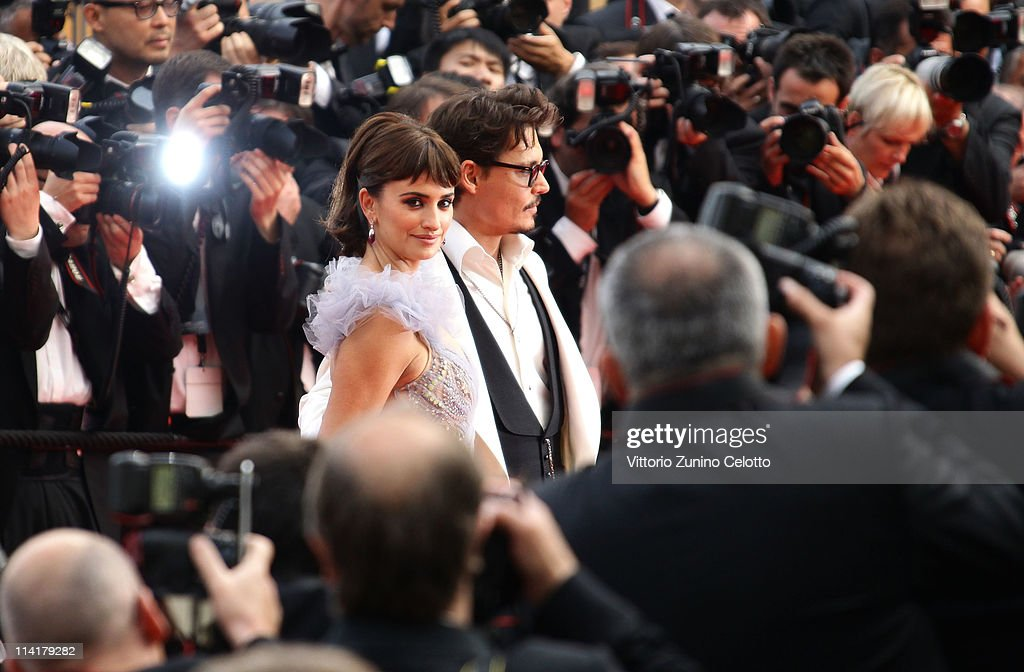 Actors <a gi-track='captionPersonalityLinkClicked' href=/galleries/search?phrase=Johnny+Depp&family=editorial&specificpeople=202150 ng-click='$event.stopPropagation()'>Johnny Depp</a> and Penelope Cruz attend the 'Pirates of the Caribbean: On Stranger Tides' premiere at the Palais des Festivals during the 64th Cannes Film Festival on May 14, 2011 in Cannes, France.