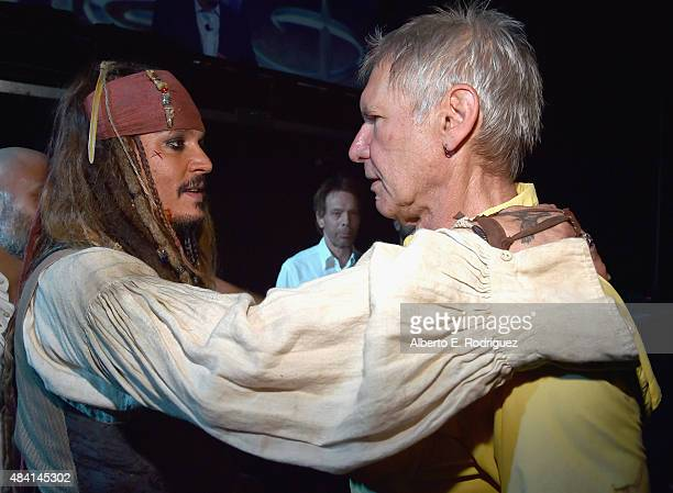 Actors Johnny Depp dressed as Captain Jack Sparrow of PIRATES OF THE CARIBBEAN DEAD MEN TELL NO TALES and Harrison Ford of STAR WARS THE FORCE...