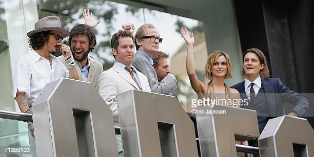 Actors Johnny Depp guest Tom Hollander Bill Nighy Keira Knightley and Orlando Bloom wave from the balcony of the Odeon at the European Premiere of...