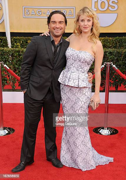 Actors Johnny Galecki and Kelli Garner arrive at the 19th Annual Screen Actors Guild Awards at The Shrine Auditorium on January 27 2013 in Los...
