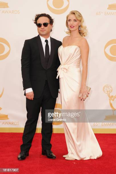 Actors Johnny Galecki and Kelli Garner arrive at the 65th Annual Primetime Emmy Awards held at Nokia Theatre LA Live on September 22 2013 in Los...