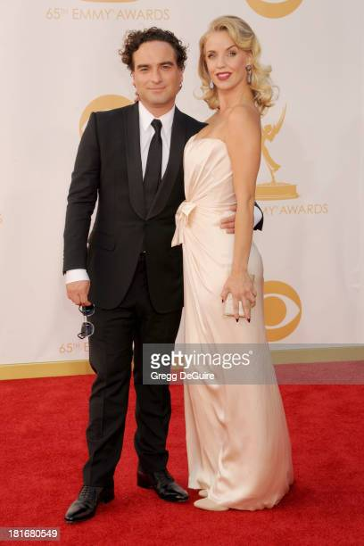 Actors Johnny Galecki and Kelli Garner arrive at the 65th Annual Primetime Emmy Awards at Nokia Theatre LA Live on September 22 2013 in Los Angeles...