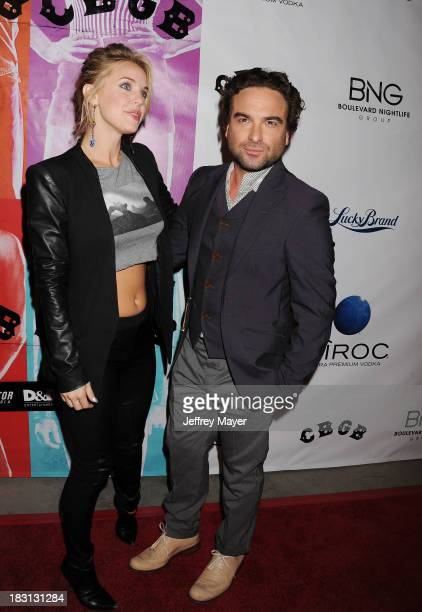Actors Johnny Galecki and Kelli Garner arrive at the 'CBGB' Special Screening at ArcLight Cinemas on October 1 2013 in Hollywood California