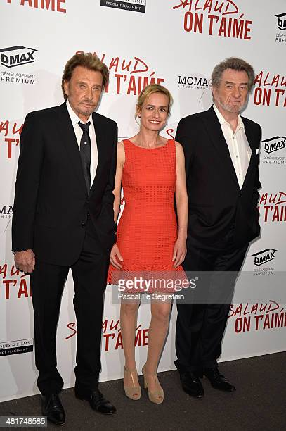 Actors Johnny Hallyday Sandrine Bonnaire and Eddy Mitchell attend 'Salaud On T'Aime' Paris Premiere at Cinema UGC Normandie on March 31 2014 in Paris...