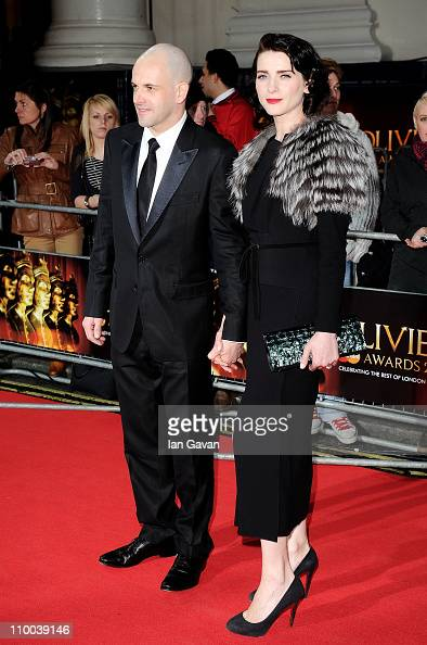 Actors Johnny Lee Miller and Michele Hicks attend The Olivier Awards 2011 at Theatre Royal on March 13 2011 in London England