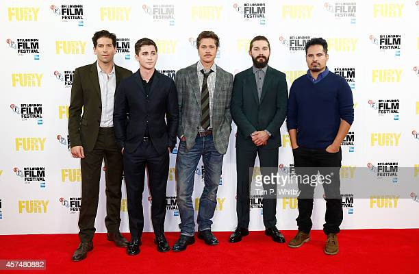Actors Jon Bernthal Logan Lerman Brad Pitt Shia LeBeouf and Michael Pena attend the photocall for 'Fury' during the 58th BFI London Film Festival at...