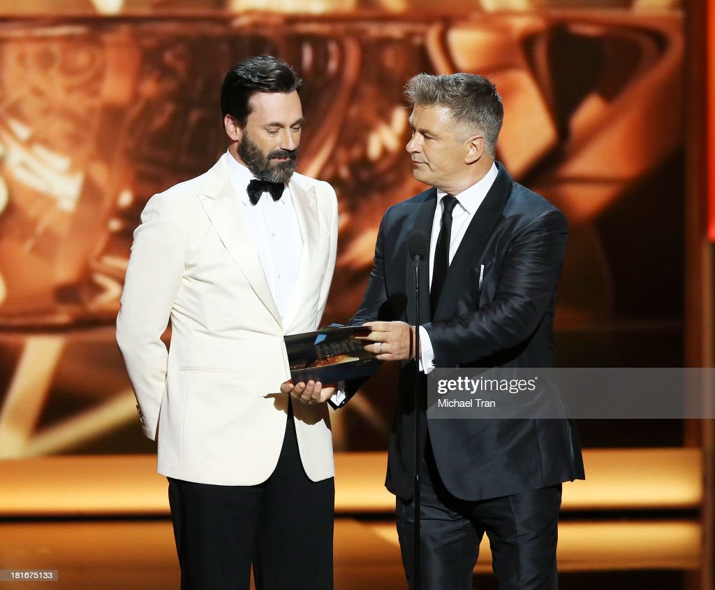 Actors Jon Hamm and Alec Baldwin speak onstage during the 65th Annual Primetime Emmy Awards held at Nokia Theatre LA Live on September 22 2013 in Los...