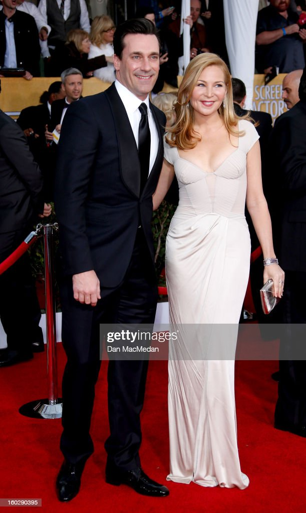 Actors Jon Hamm (L) and Jennifer Westfeldt arrive at the 19th Annual Screen Actors Guild Awards at the Shrine Auditorium on January 27, 2013 in Los Angeles, California.
