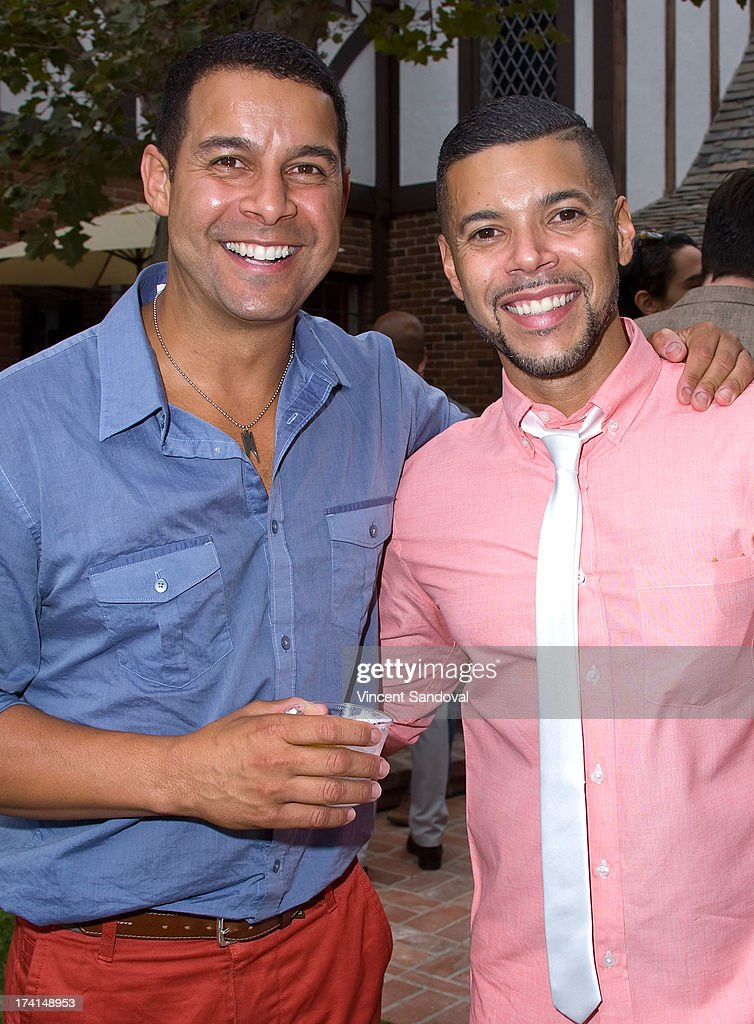 Actors Jon Huertas and Wilson Cruz attend GLAAD's annual food-themed fundraiser 'GLAAD Hancock Park' on July 20, 2013 in Los Angeles, California.