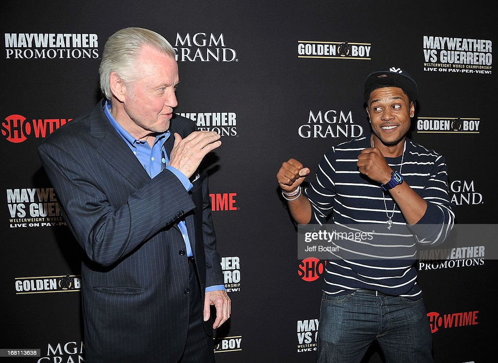 Actors Jon Voight (L) and Pooch Hall arrive at a VIP pre-fight party at the WBC welterweight title fight between Floyd Mayweather Jr. and Robert Guerrero at the MGM Grand Hotel/Casino on May 4, 2013 in Las Vegas, Nevada.