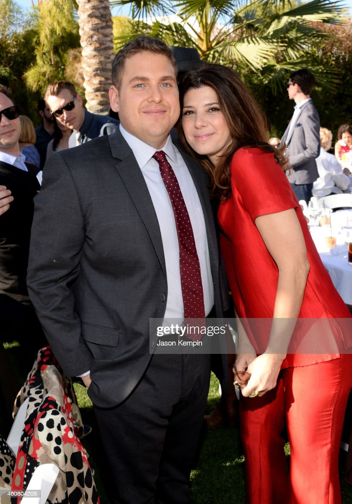 Actors <a gi-track='captionPersonalityLinkClicked' href=/galleries/search?phrase=Jonah+Hill&family=editorial&specificpeople=544481 ng-click='$event.stopPropagation()'>Jonah Hill</a> and <a gi-track='captionPersonalityLinkClicked' href=/galleries/search?phrase=Marisa+Tomei&family=editorial&specificpeople=201516 ng-click='$event.stopPropagation()'>Marisa Tomei</a> attend Variety's Creative Impact Awards and 10 Directors to Watch brunch presented by Mercedes-Benz at The 25th Annual Palm Springs International Film Festival at Parker Palm Springs on January 5, 2014 in Palm Springs, California.