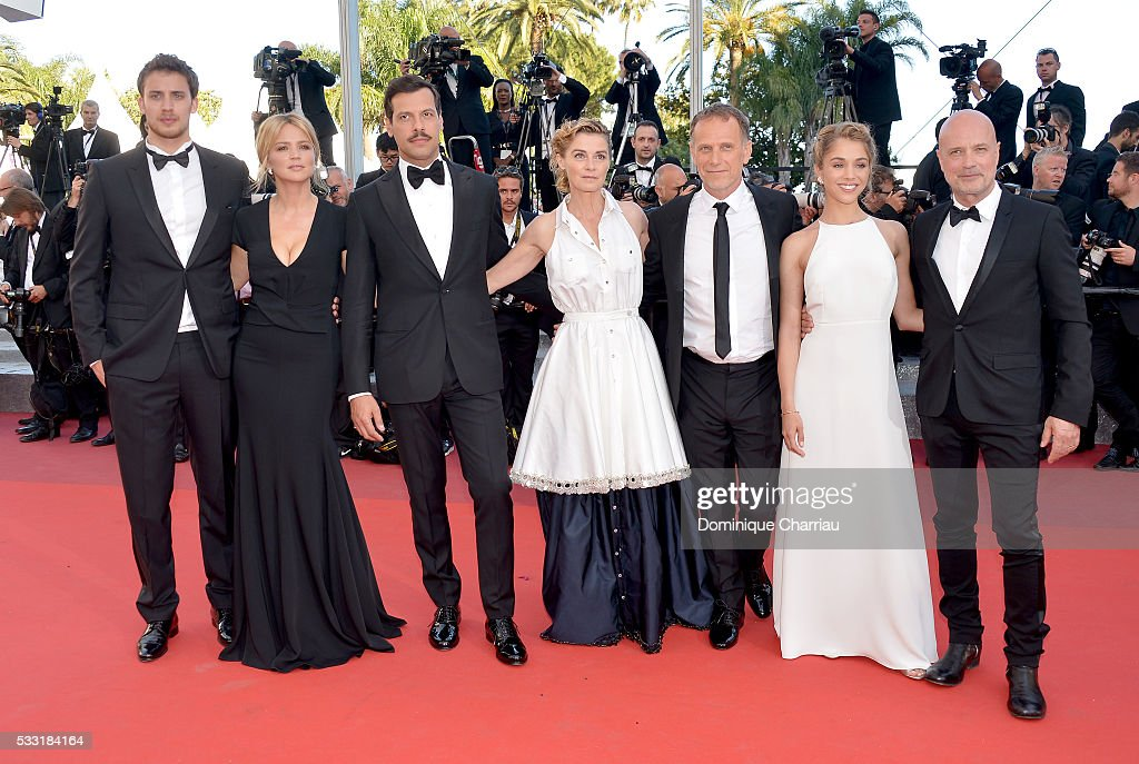 Actors Jonas Bloquet, Virginie Efira, Laurent Lafitte, Anne Consigny, Charles Berling, Alice Isaaz and Christian Berkel attend the 'Elle' Premiere during the 69th annual Cannes Film Festival at the Palais des Festivals on May 21, 2016 in Cannes, France.