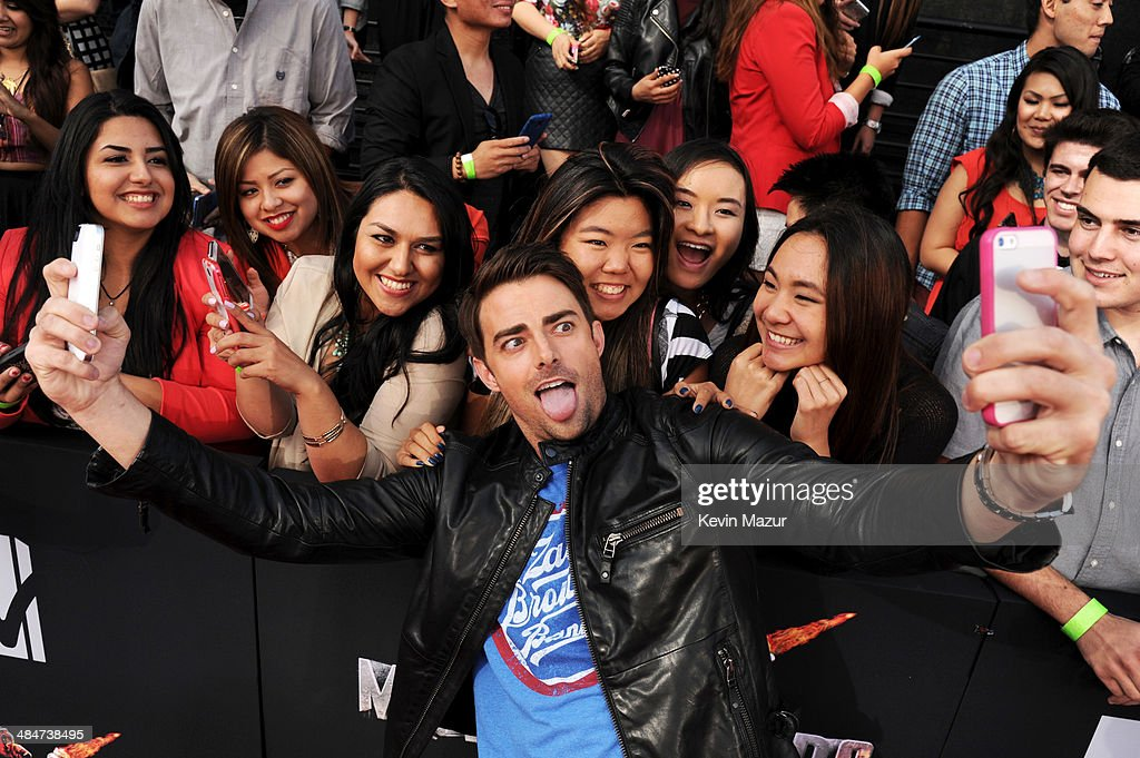 Actors <a gi-track='captionPersonalityLinkClicked' href=/galleries/search?phrase=Jonathan+Bennett&family=editorial&specificpeople=233425 ng-click='$event.stopPropagation()'>Jonathan Bennett</a> takes a selfie with fans during the 2014 MTV Movie Awards at Nokia Theatre L.A. Live on April 13, 2014 in Los Angeles, California.