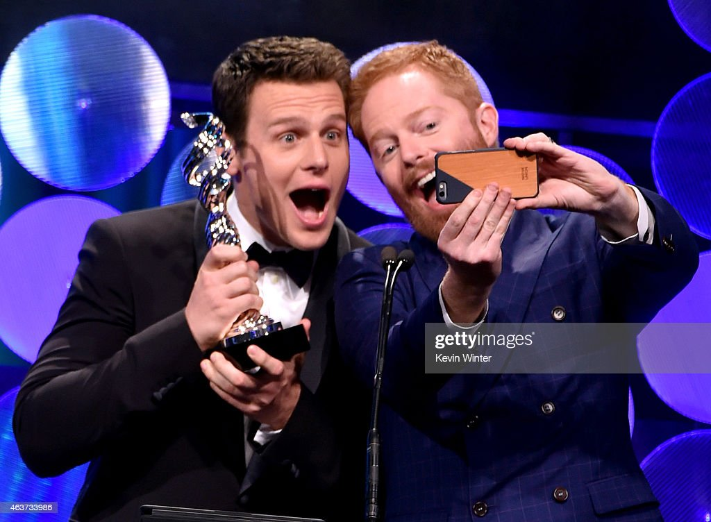 Actors Jonathan Groff and Jesse Tyler Ferguson present award onstage during 17th Costume Designers Guild Awards with presenting sponsor Lacoste at...