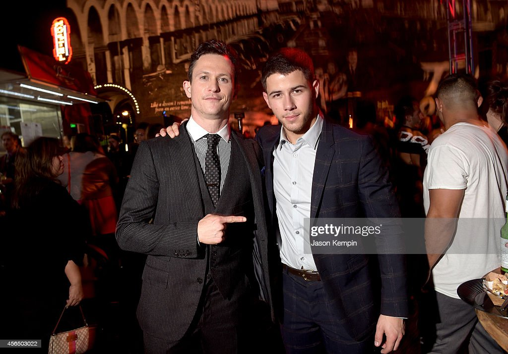 Actors Jonathan Tucker and Nick Jonas attend the Premiere Event for DIRECTV's KINGDOM on October 1 2014 in Venice California
