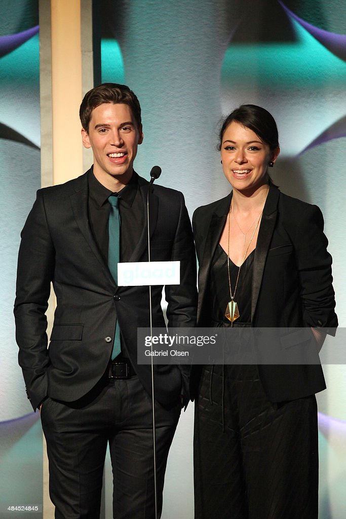 Actors Jordan Gavaris (L) and <a gi-track='captionPersonalityLinkClicked' href=/galleries/search?phrase=Tatiana+Maslany&family=editorial&specificpeople=4489724 ng-click='$event.stopPropagation()'>Tatiana Maslany</a> speak onstage during the 25th Annual GLAAD Media Awards at The Beverly Hilton Hotel on April 12, 2014 in Beverly Hills, California.