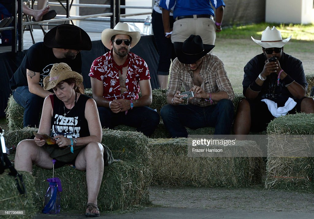 Actors Jordan Masterson (L) and Ashton Kutcher during 2013 Stagecoach: California's Country Music Festival held at The Empire Polo Club on April 28, 2013 in Indio, California.
