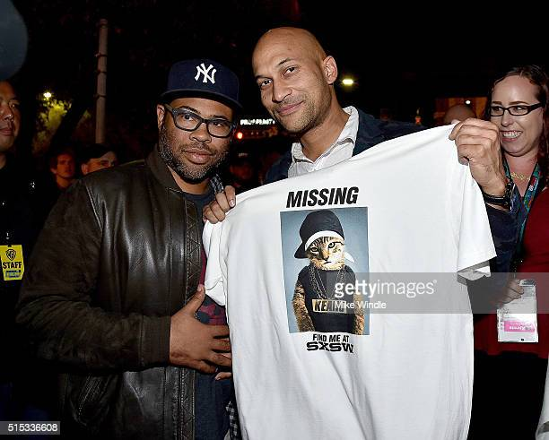 Actors Jordan Peele and KeeganMichael Key pass out tshirts to fans waiting in line for the screening of 'Keanu' during the 2016 SXSW Music Film...