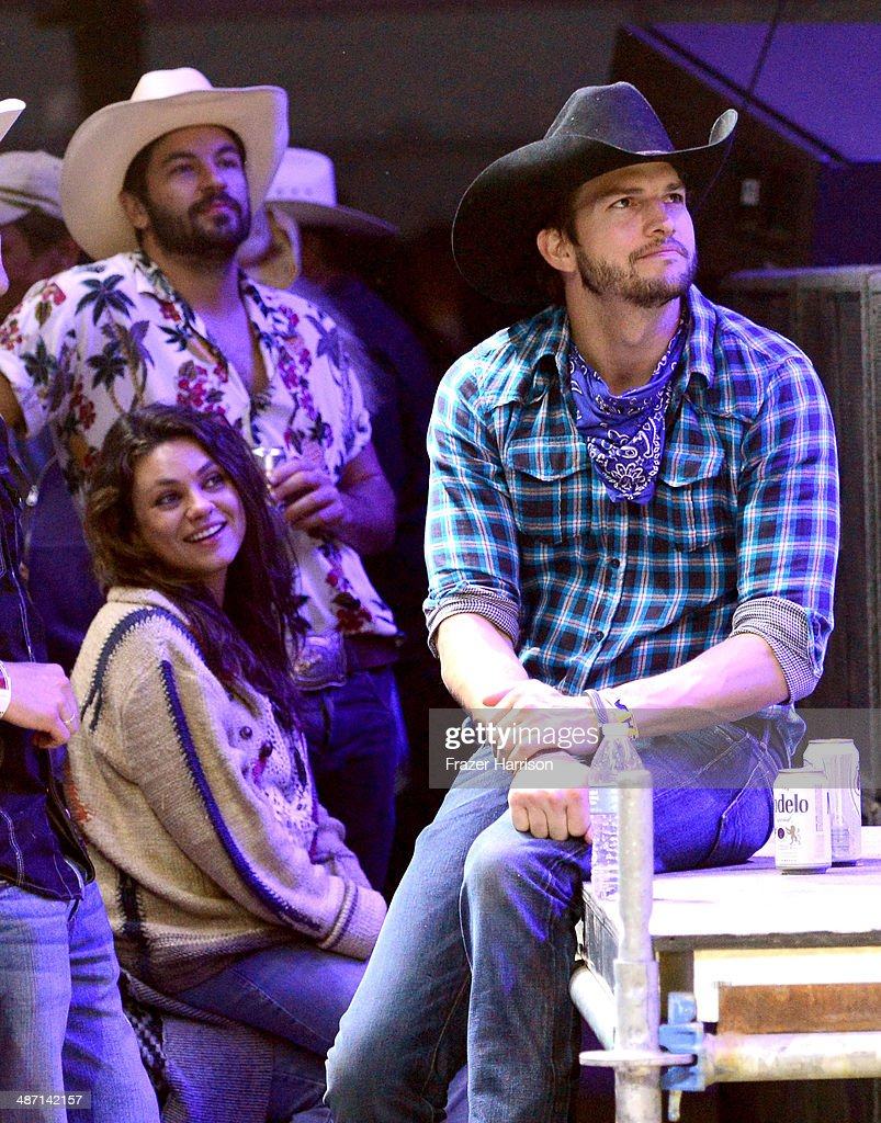Actors Jordy Masterson, Mila Kunis and Ashton Kutcher seen during day 3 of 2014 Stagecoach: California's Country Music Festival at the Empire Polo Club on April 27, 2014 in Indio, California.