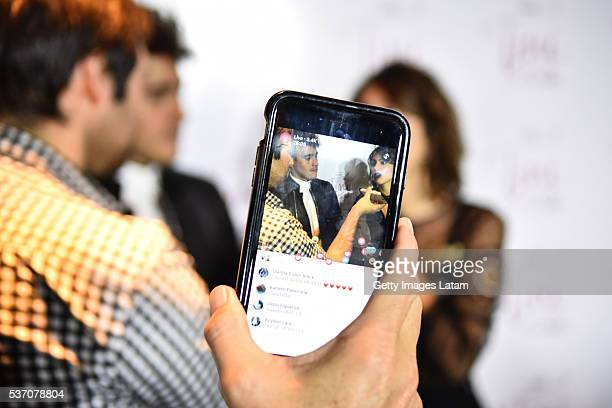 Actors Jorge Blanco and Martina Stoessel are seen on a mobile phone screen prior to TINI El Gran Cambio de Violetta The Avant Premiere on May 31 2016...