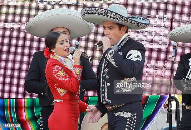 Actors Jorge Salinas and Danna Garcia perform on stage during Univision Network's New Novela 'Que Bonito Amor' Press Conference and fan meet and...
