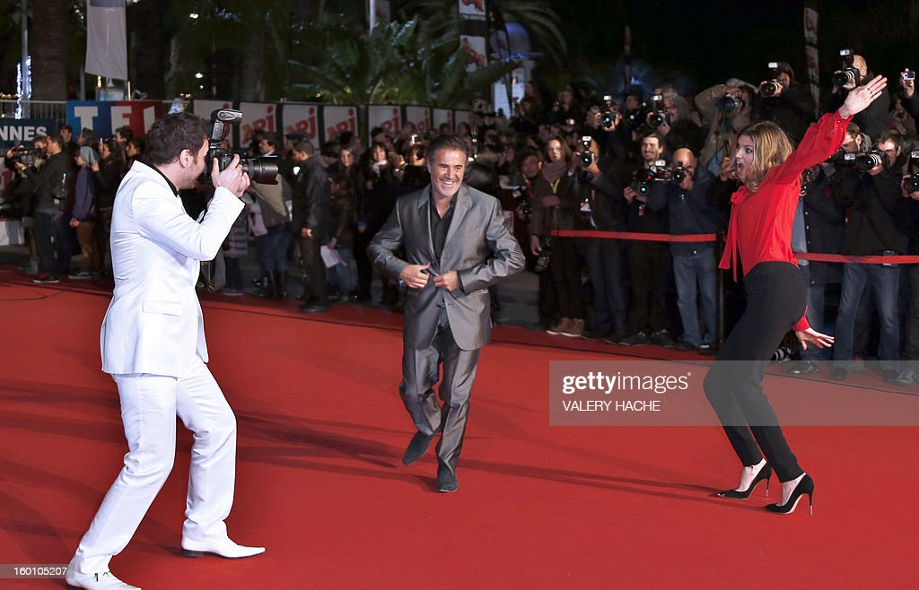 Actors Jose Garcia (C) Isabelle Funaro (R) and Michael Youn (R) pose upon arrival at the Palais des Festivals during the 14th Annual NRJ Music Awards on January 26, 2013 in Cannes, southeastern France. News that the global music industry has finally turned the corner and is on the road to recovery should help get the annual four-day gathering of many of the world's top music execs at the MIDEM trade fair that opens here Saturday off to a good start. AFP PHOTO / VALERY HACHE