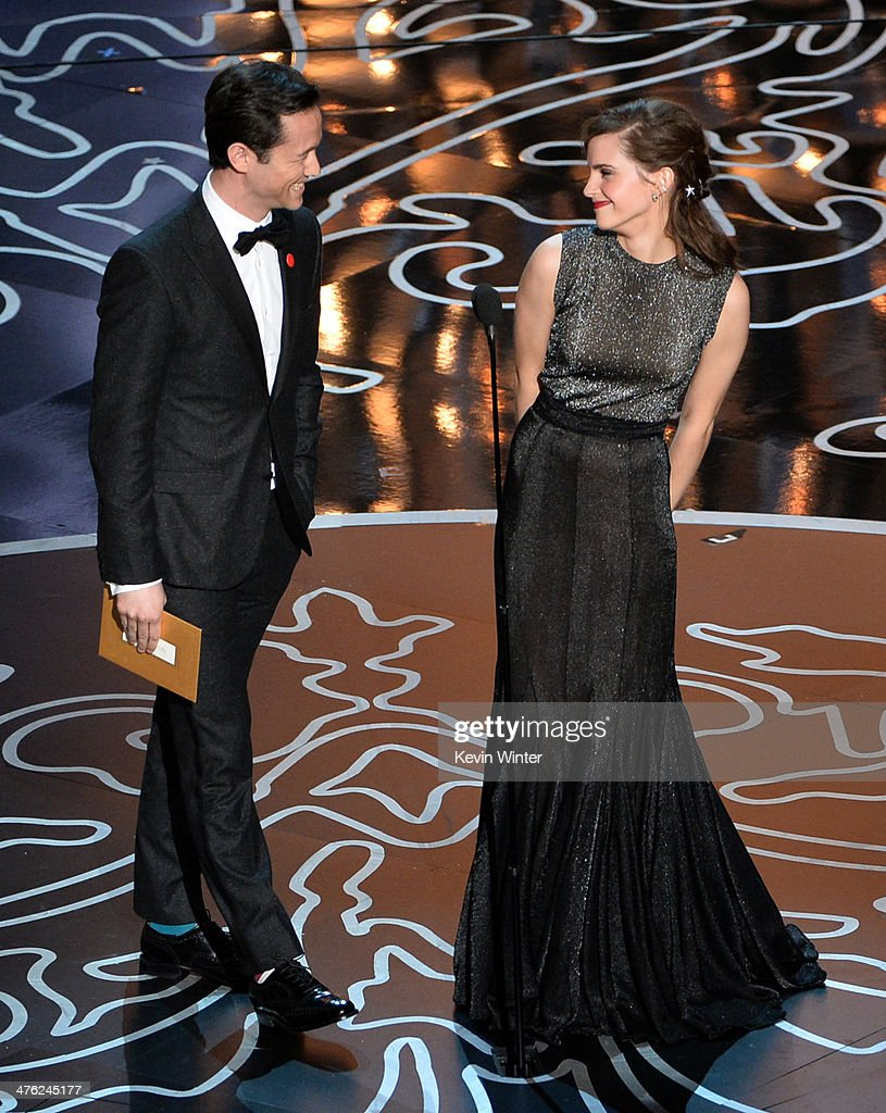 Actors Joseph GordonLevitt and Emma Watson speak onstage during the Oscars at the Dolby Theatre on March 2 2014 in Hollywood California