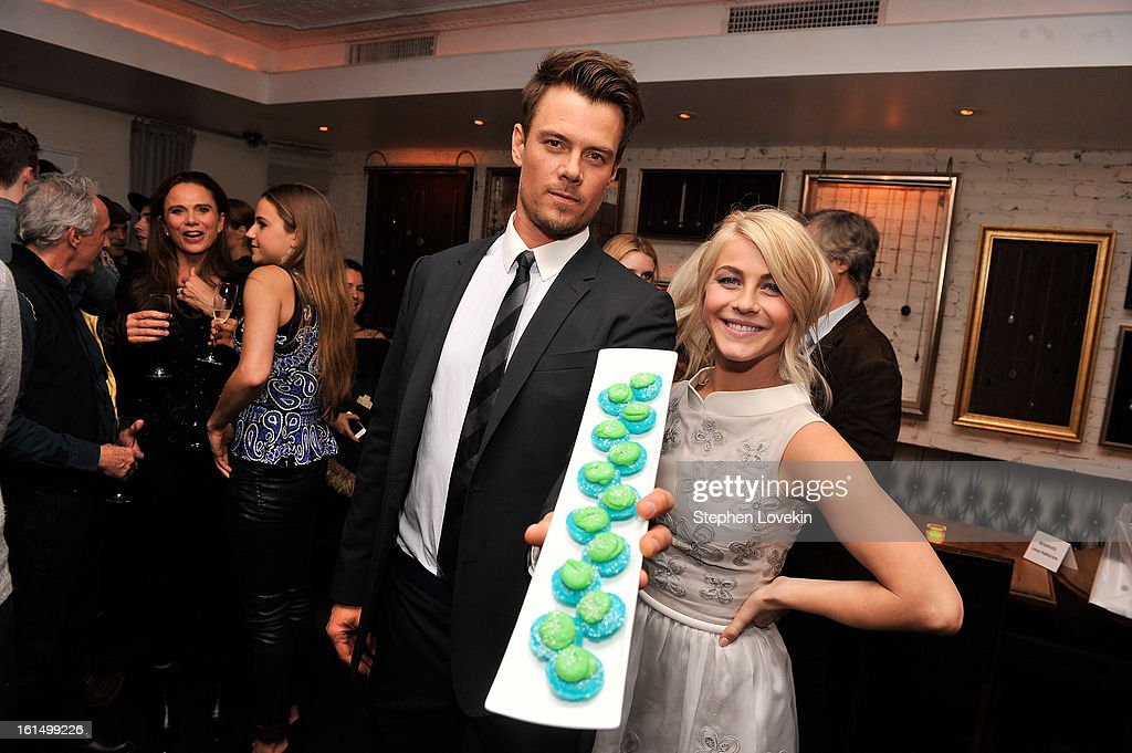 Actors <a gi-track='captionPersonalityLinkClicked' href=/galleries/search?phrase=Josh+Duhamel&family=editorial&specificpeople=208740 ng-click='$event.stopPropagation()'>Josh Duhamel</a> and <a gi-track='captionPersonalityLinkClicked' href=/galleries/search?phrase=Julianne+Hough&family=editorial&specificpeople=4237560 ng-click='$event.stopPropagation()'>Julianne Hough</a> hold Baked By Melissa 'Safe Haven' themed cupcakes at the after-party for SELF Magazine and Relativity Media's special New York screening of 'Safe Haven' at Beauty and Essex on February 11, 2013 in New York City.