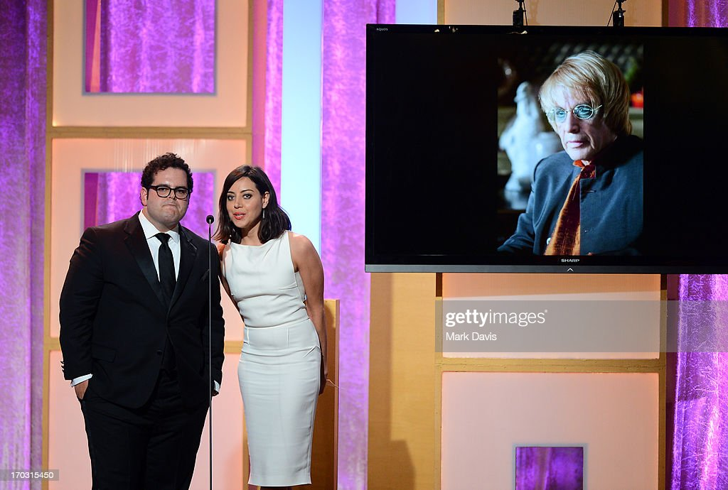 Actors <a gi-track='captionPersonalityLinkClicked' href=/galleries/search?phrase=Josh+Gad&family=editorial&specificpeople=4196023 ng-click='$event.stopPropagation()'>Josh Gad</a> and <a gi-track='captionPersonalityLinkClicked' href=/galleries/search?phrase=Aubrey+Plaza&family=editorial&specificpeople=5299268 ng-click='$event.stopPropagation()'>Aubrey Plaza</a> speak onstage during Broadcast Television Journalists Association's third annual Critics' Choice Television Awards at The Beverly Hilton Hotel on June 10, 2013 in Los Angeles, California.