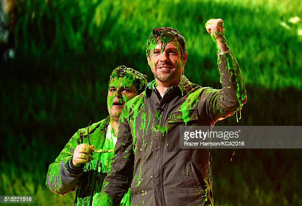 Actors Josh Gad and Jason Sudeikis get slimed onstage at Nickelodeon's 2016 Kids' Choice Awards at The Forum on March 12 2016 in Inglewood California