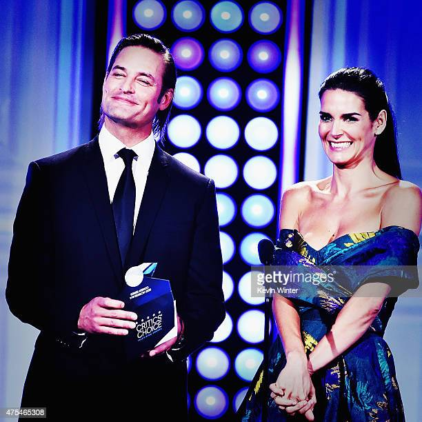 Actors Josh Holloway and Angie Harmon speak onstage during the 5th Annual Critics' Choice Television Awards at The Beverly Hilton Hotel on May 31...