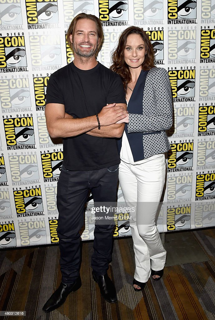 Actors Josh Holloway (L) and Sarah Wayne Callies attend the 'Colony' press room during Comic-Con International 2015 at the Hilton Bayfront on July 10, 2015 in San Diego, California.