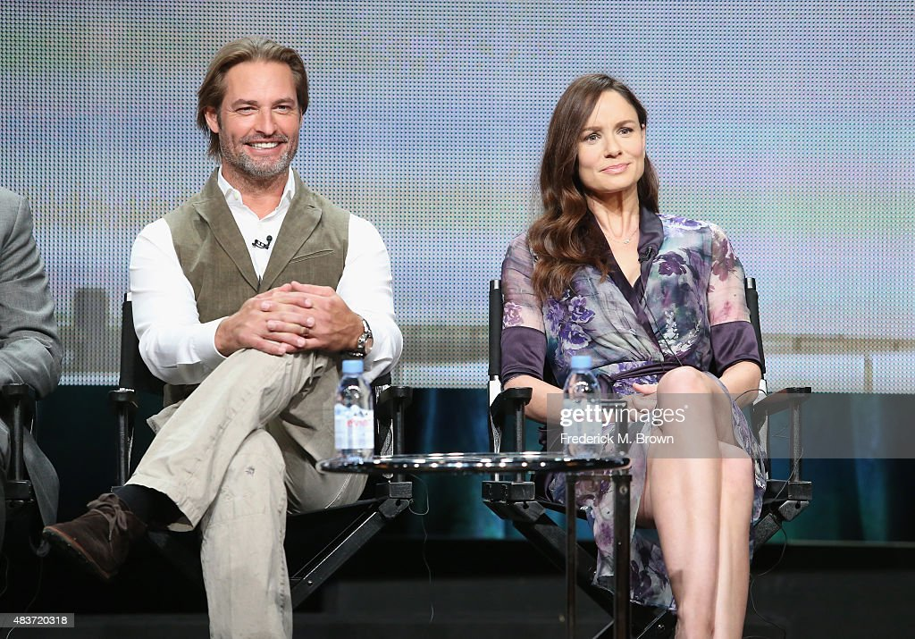 Actors Josh Holloway and Sarah Wayne Callies speak onstage during the USA Networks' 'Colony' panel discussion at the NBCUniversal portion of the 2015 Summer TCA Tour at The Beverly Hilton Hotel on August 12, 2015 in Beverly Hills, California.